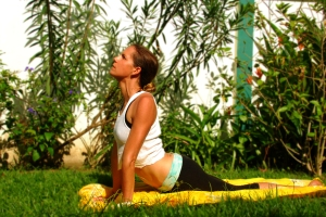 Inhale as you stretch gently up to cobra/upward facing dog. Contract your glutes and keep shoulders down away from the ears.